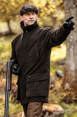 man wearing Deerhunter Woodland Waterproof Shooting Jacket | Loden Green