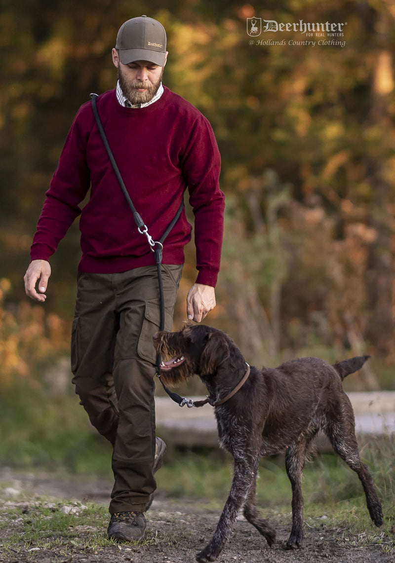 Man Dog walking in Red pullover