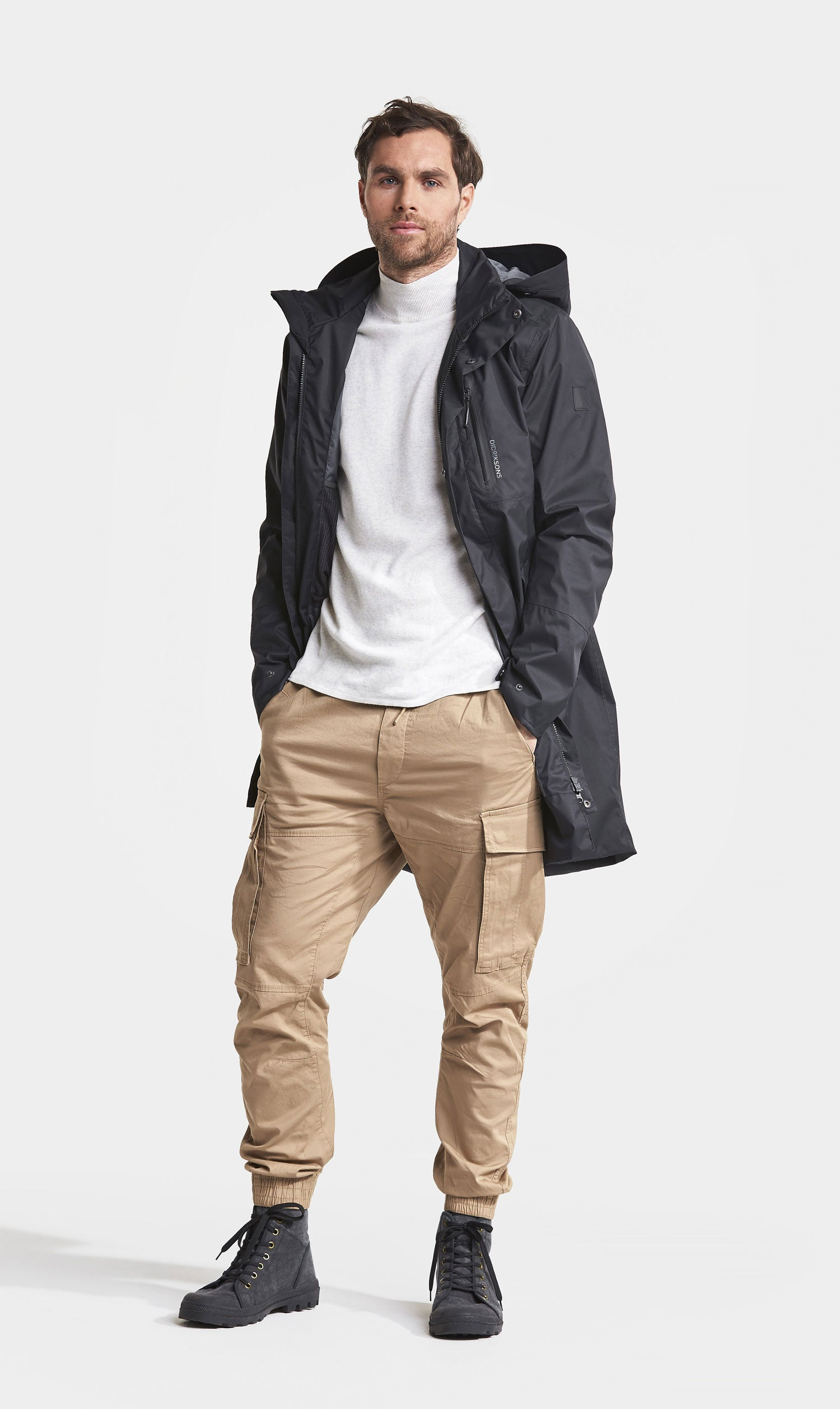 Didriksons Arnold Parka Coat worn by a man over a white sweater