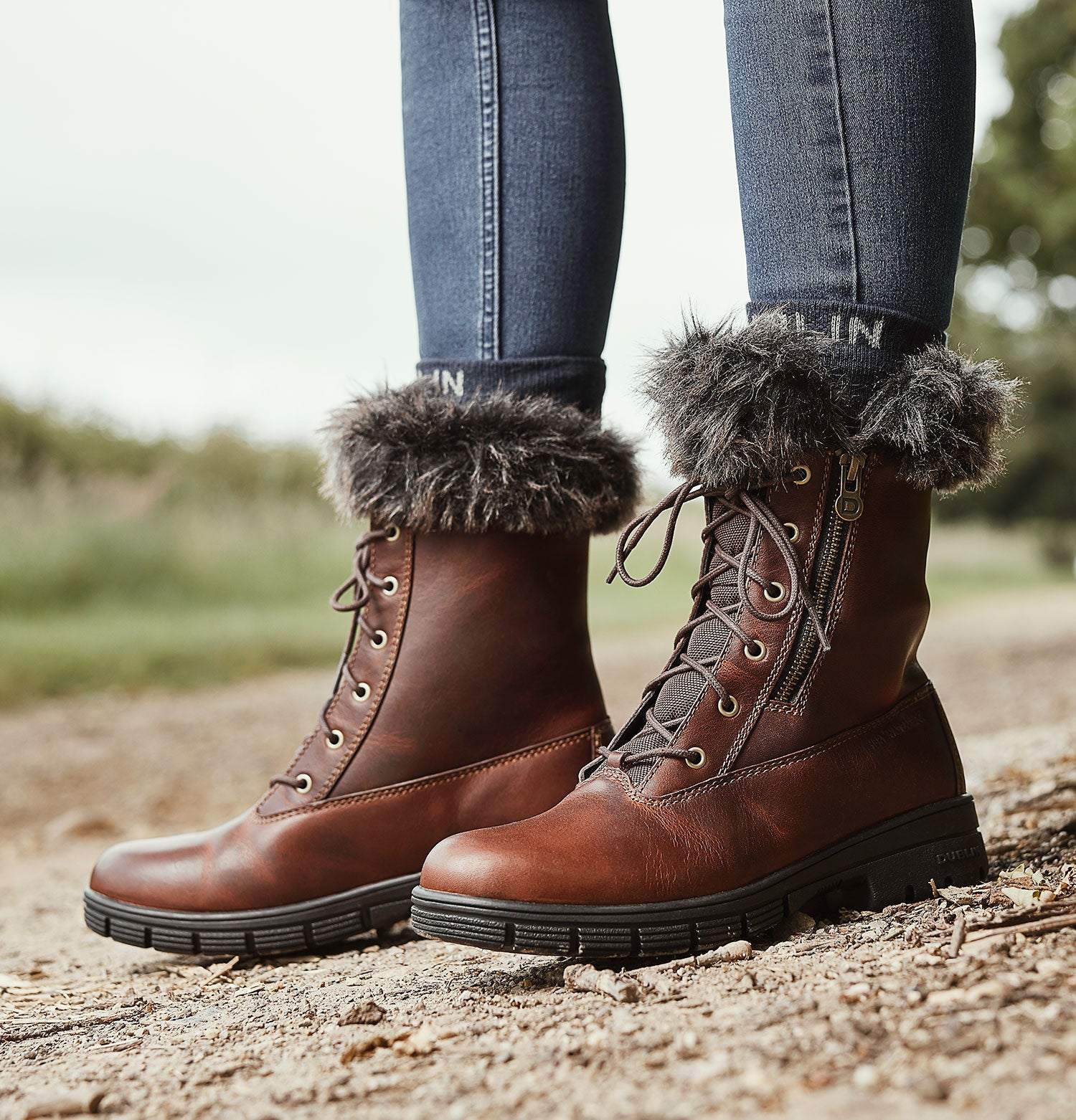 Brown Leather boots with fur trim and zip sides