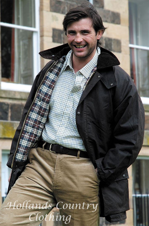 man wearing The Hoggs of Fife Padded Waxed Jacket in brown