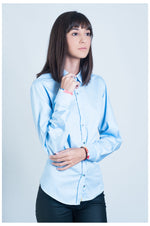 Ladies blue shirt with colourful flower trim