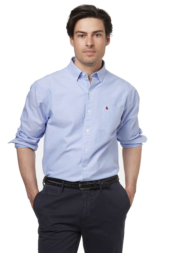 Man Wearing 100% cotton oxford shirt with sleeves rolled up