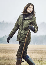 Out and about woman wears Musto Waterproof coat