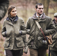 Manwith woman on shooting trip