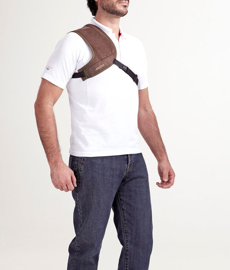 Shoulder pad with strap to protect shoulder during shooting