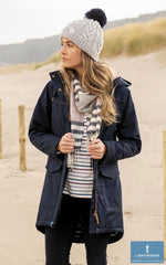 On the beach with Alanna Quilted Waterproof Coat by Lighthouse
