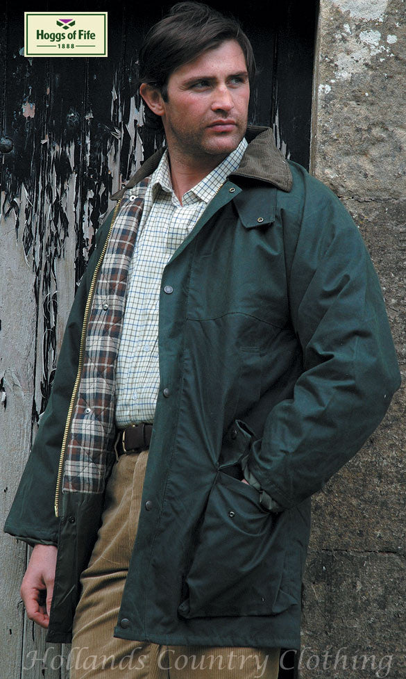 man wearing The Hoggs of Fife Padded Waxed Jacket in olive colour