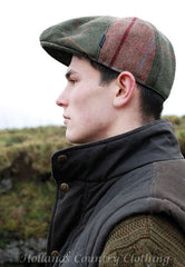 man wearing Jack Murphy Devon Patchwork Tweed Flat Cap