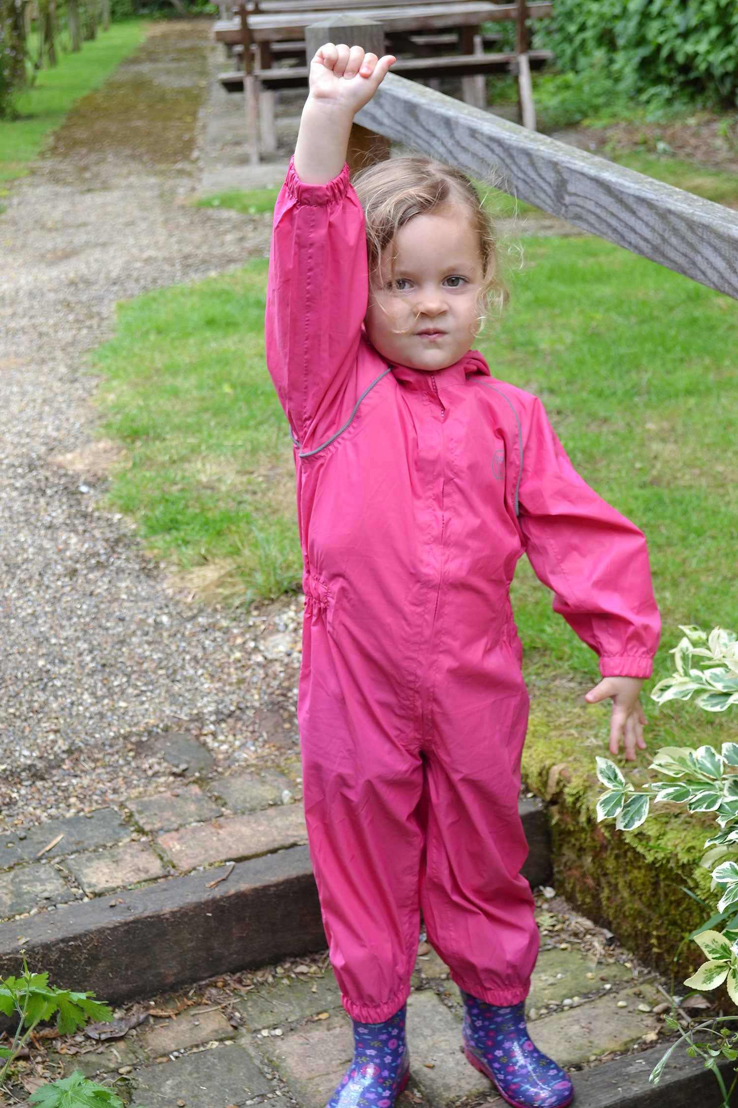 Girl in Pink rainsuit and wellies
