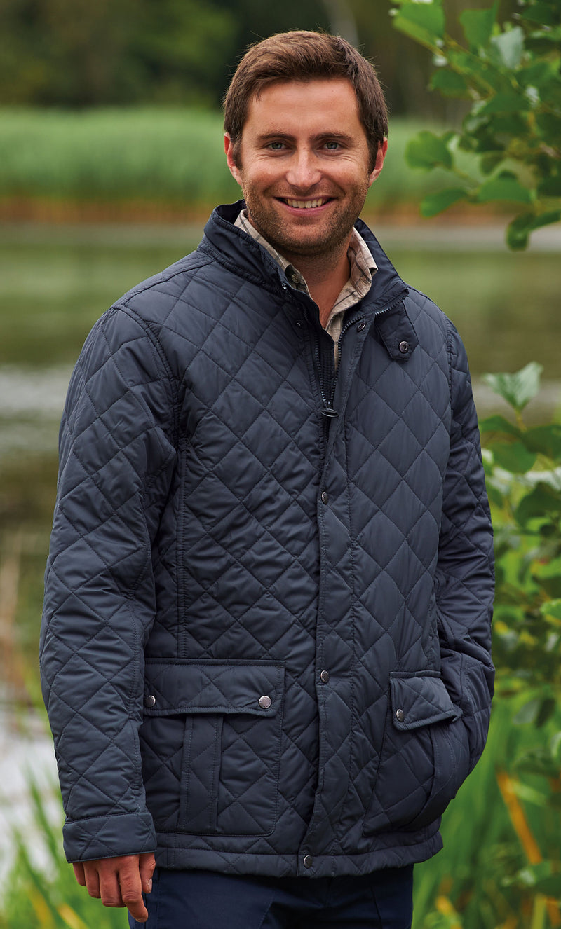 Man wearing diamond quilted country jacket navy