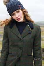 Isabella tweed frock coat In striking green with bold red and blue overcheck