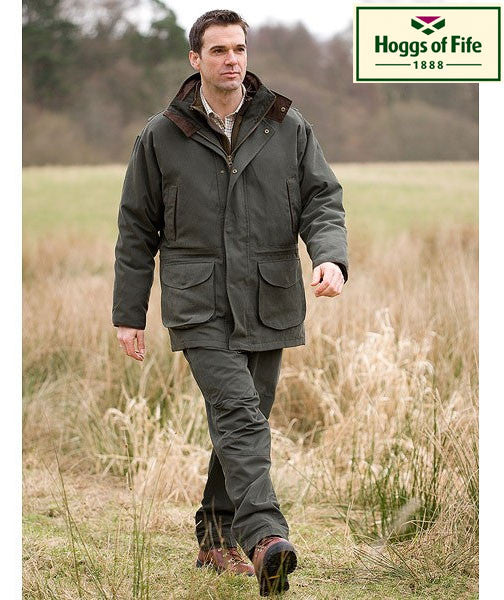 farmer walking in Hoggs Ranger 3 in 1 Waterproof Field Jacket