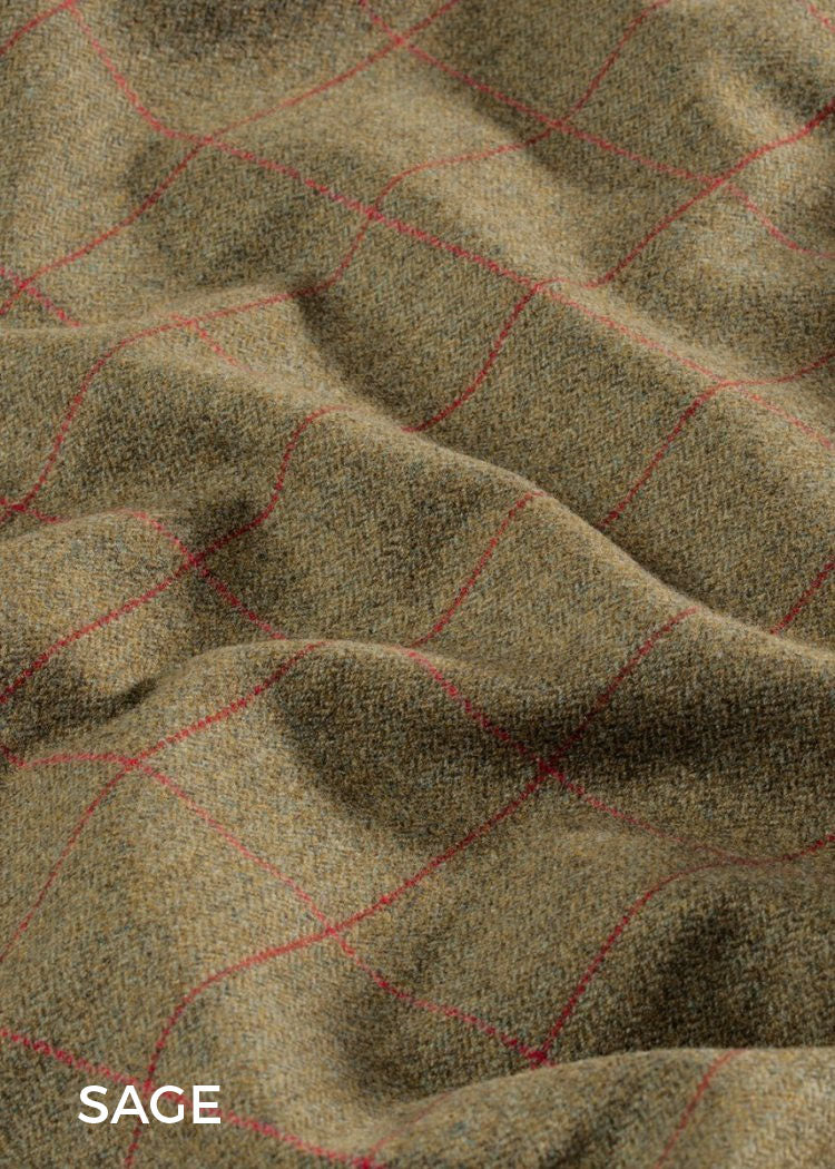 Sage; Reflecting the flowing green hues of the English countryside and with a cherry red over-check, sage is a popular traditional coloured tweed.