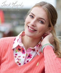 lady wearing Jack Murphy Rosemary Ladies Shirt in blossom wonder bright pink and red flower pattern
