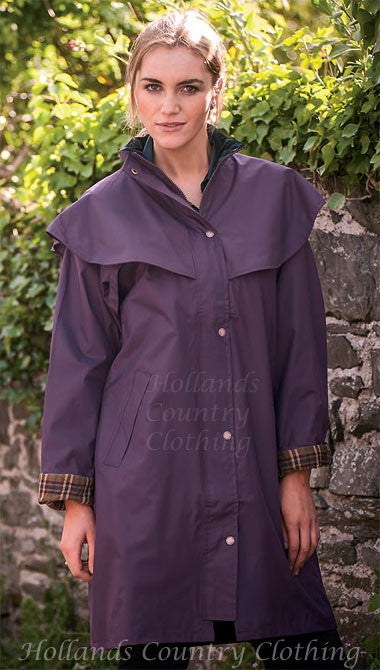 lady in Outrider II 3/4 Length Rain Coat by Target Dry.