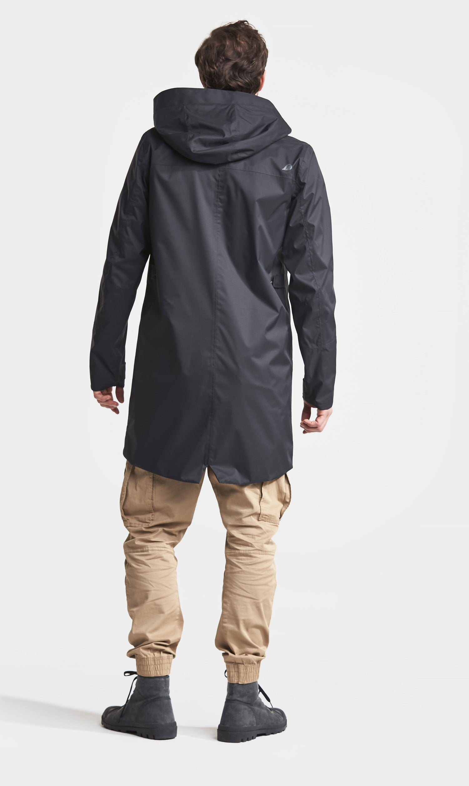 Rear view showing coat's parka tail