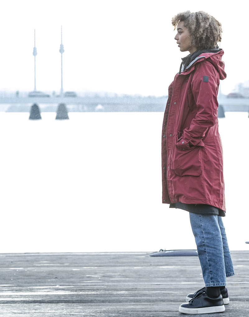 Swedish Dock side  - woman wearing a Red Parka Coat