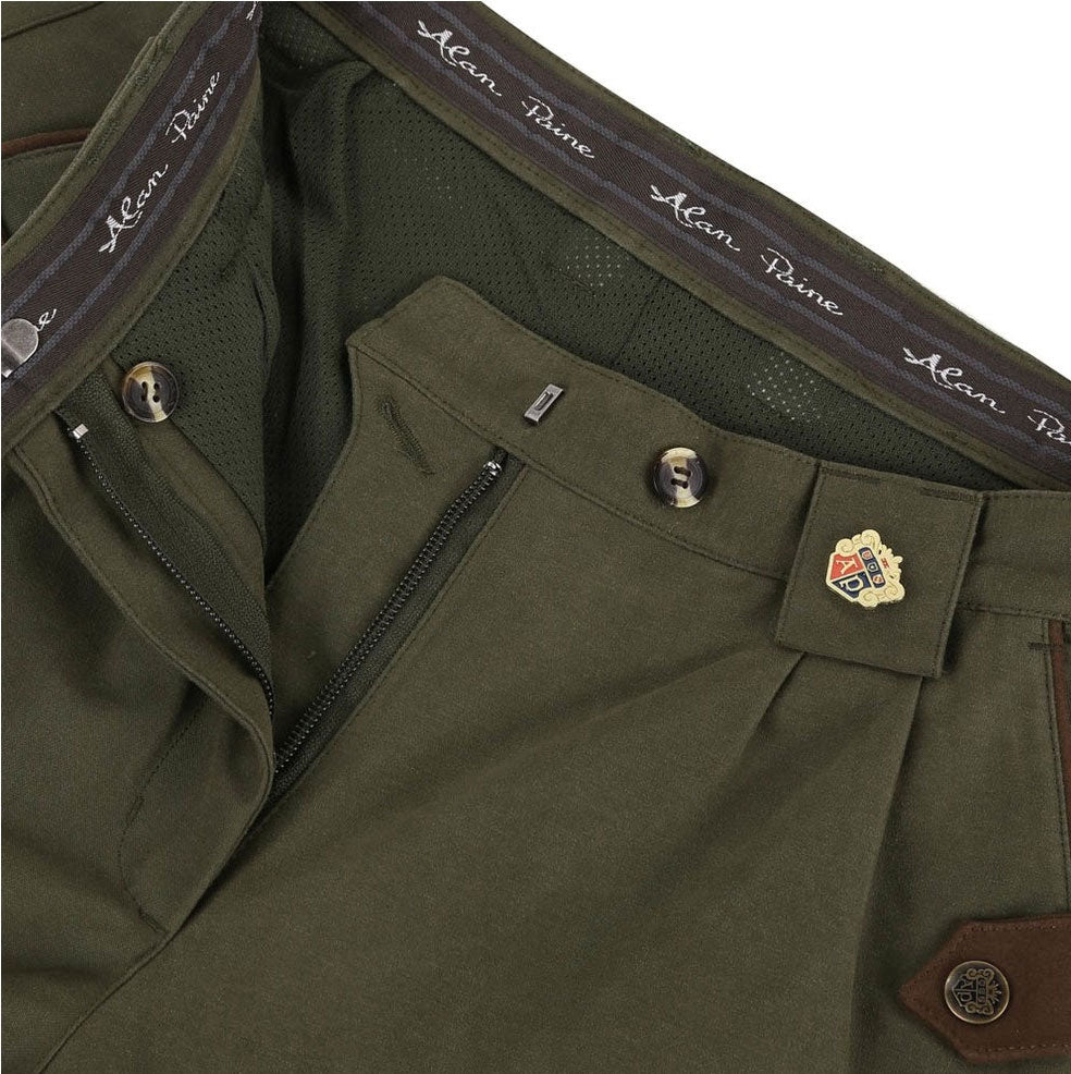 showing waistband, zip fly, mesh lining and alan paine badge