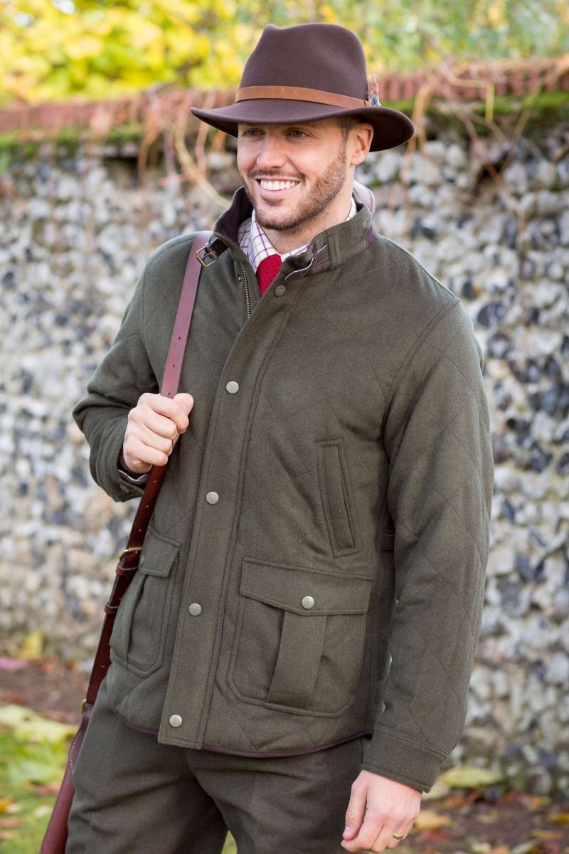 man shooting wearing Alan Paine Loden Quilted Jacket
