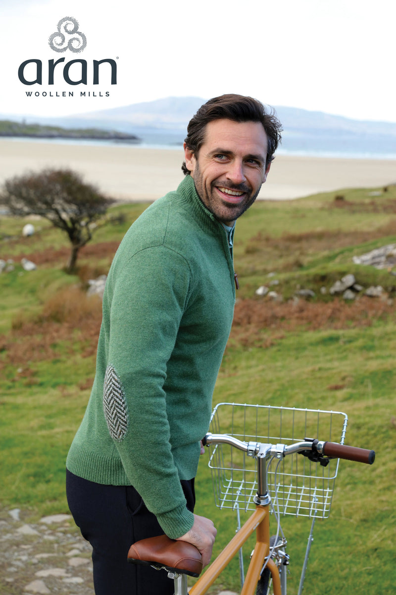 Man with bike wearing Aran Merino Wool Zip Neck Sweater