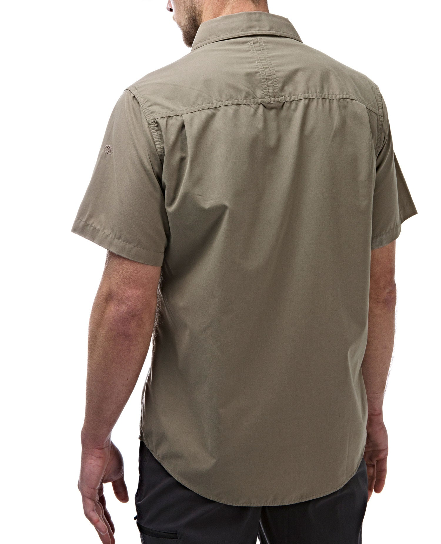 rear view scooped hem Cedar green Man's Bush shirt with short sleeves