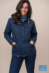 lady wearing Lighthouse Beaufort Waterproot Jacket in yellow, navy and berry