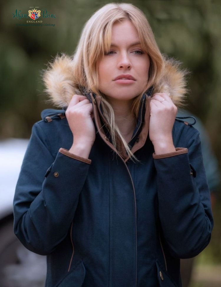 attractive lady puts up her hood on long coat