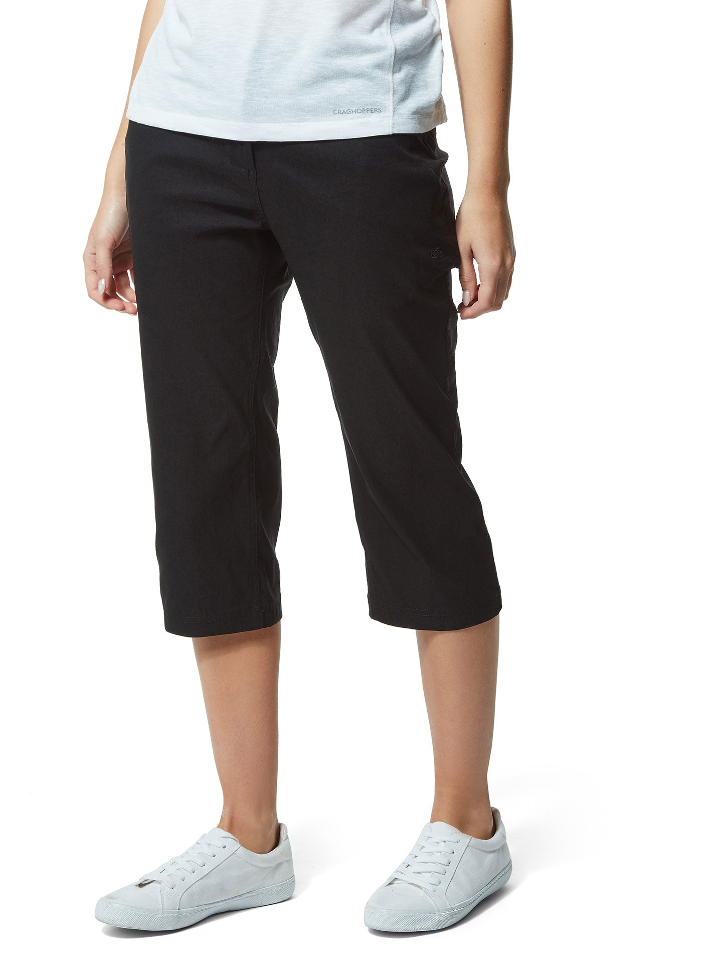 Lady wears Black Craghoppers Kiwi Pro Crop II Trousers