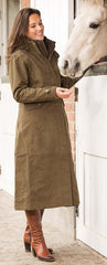 lady wearing Baleno Kensington Long Waterproof Coat with a horse