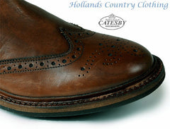 Brogue toe cap showing pattern cut into leather