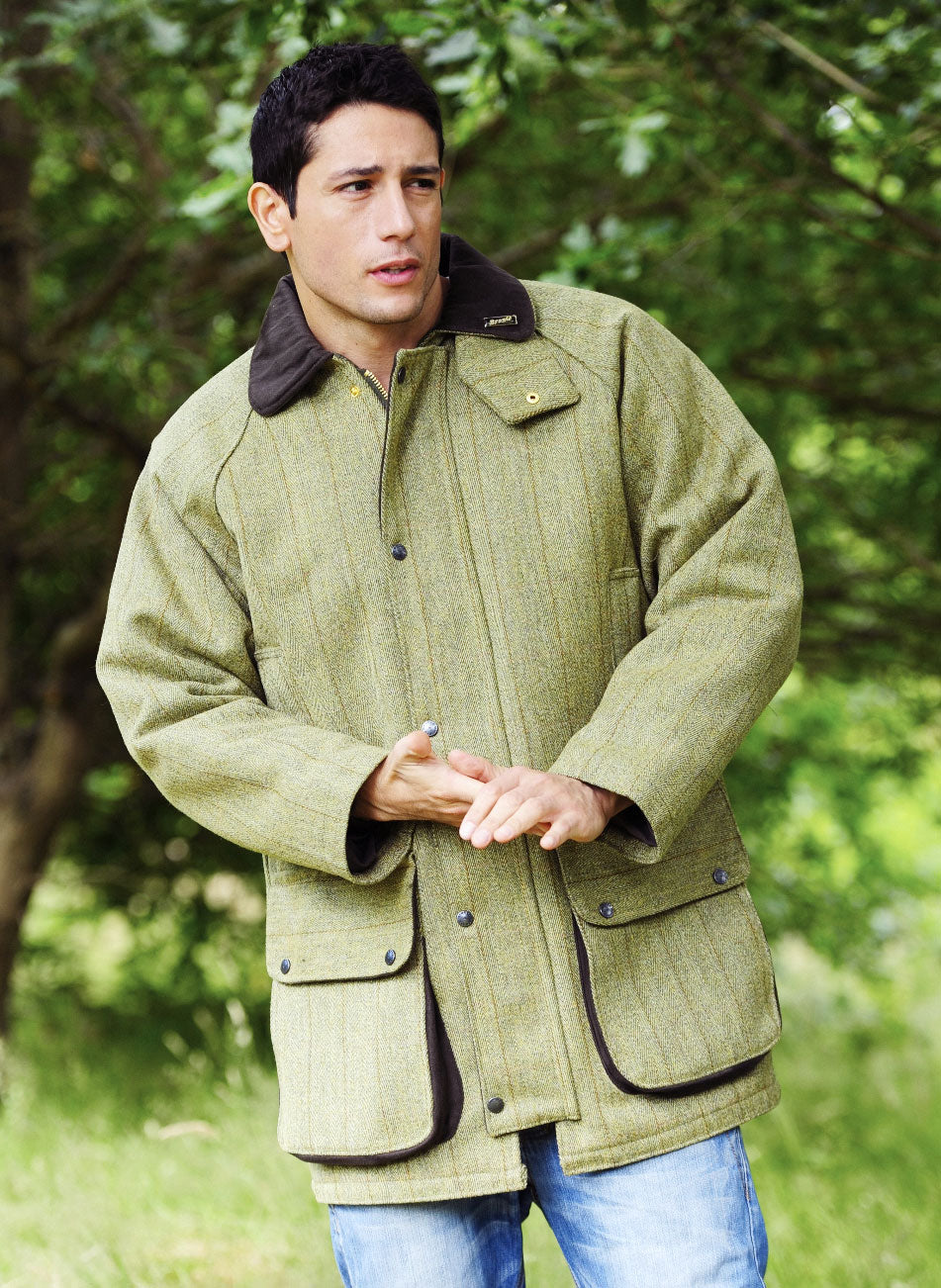 70ffcc2c220d1 Man wearing bronte quality tweed shooting field coat in Derby wool tweed