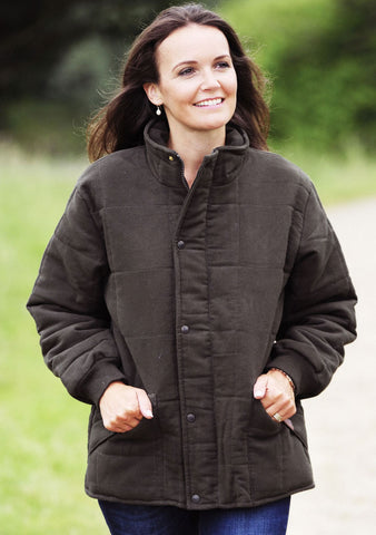 lady in Bronte Quilted Moleskin Jacket. Green