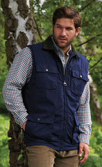 man wearing navy Silverdale Multi Pocket Waistcoat from Champion Outdoor