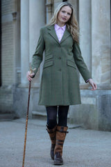 Lady wears Combrook Tweed Midi Coat by Alan Paine