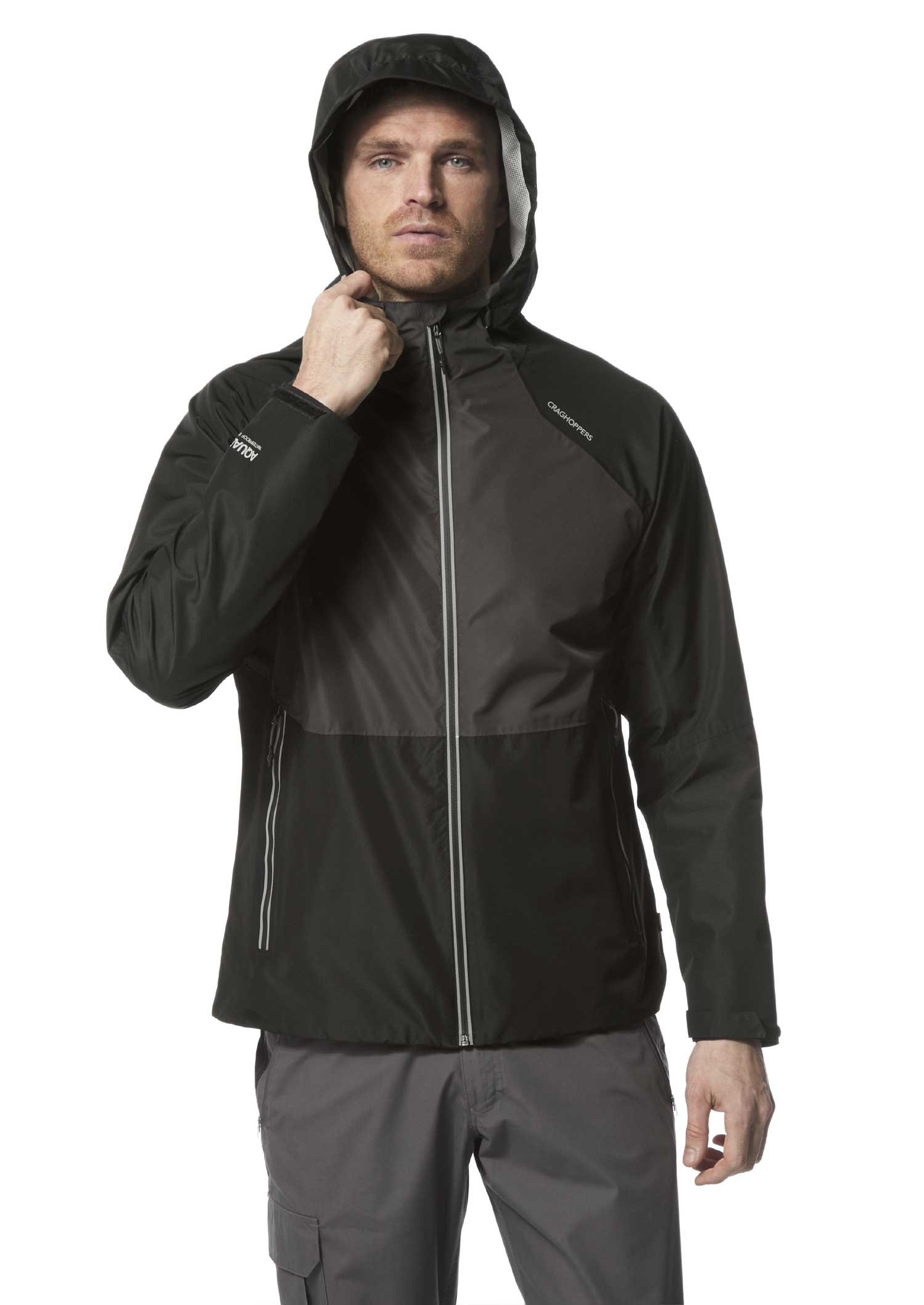 Man wears Horizon Waterproof Jacket by Craghoppers with the hood up