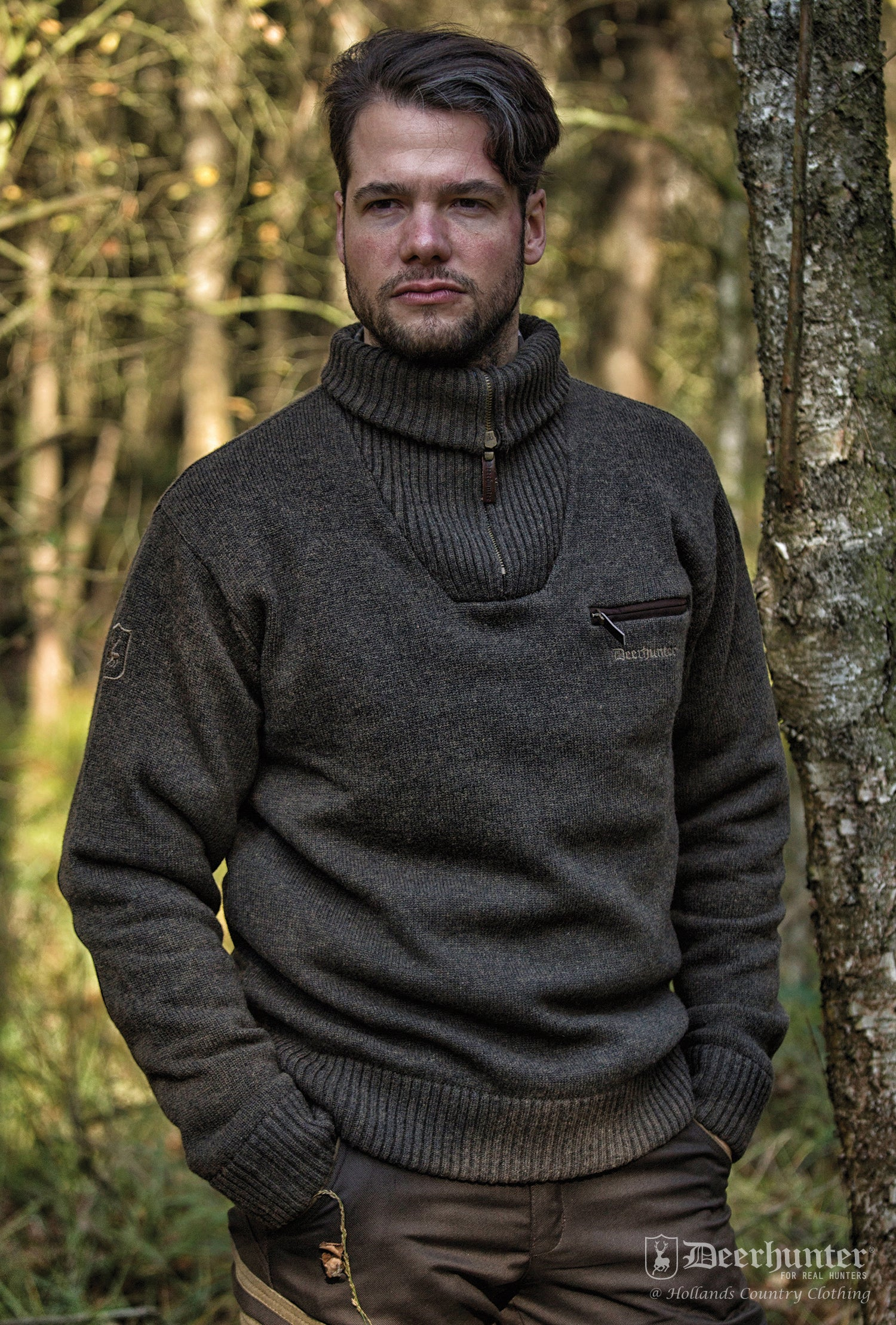 man wearing chunky sweater with the collar folded down