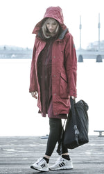 Lady wearing Red Parka coat