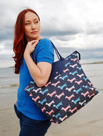 lady on the beach with Jack Murphy Quinn Carry All Bag