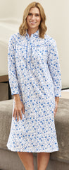 blonde lady in a blue floral cotton nightie