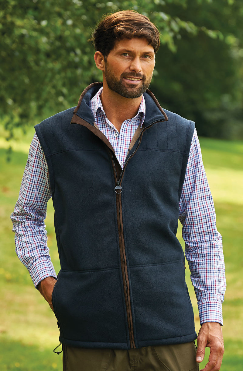 man in  a micro fleece lined gilet in navy by champion
