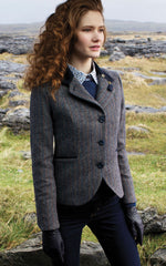 lady with fabulous red hair in english tweed hacking jacket