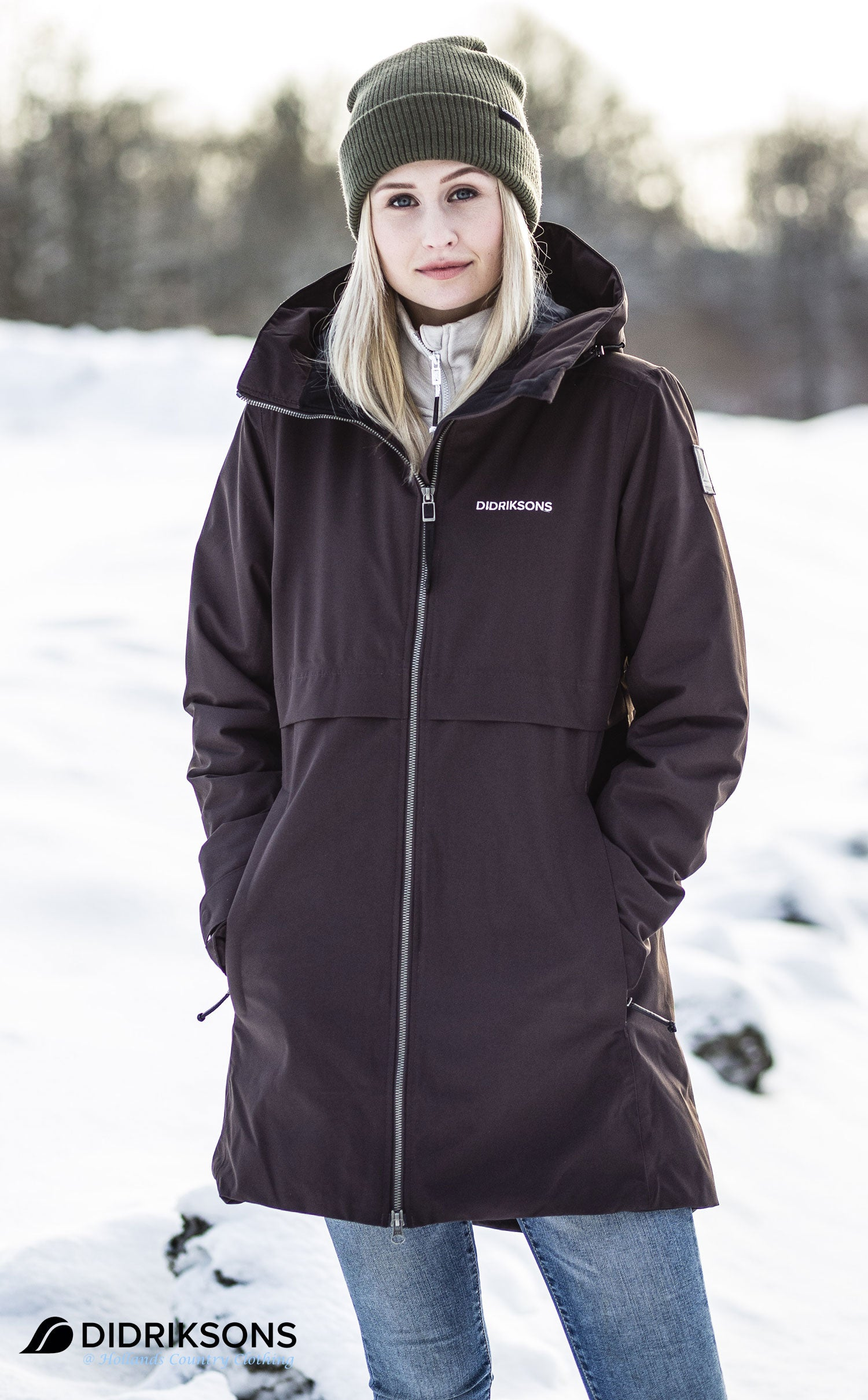 woman wearin women's waterproof Parka by Didriksons - Scandinavia's leading outdoor clothing specialists is a stylish 3/4 length