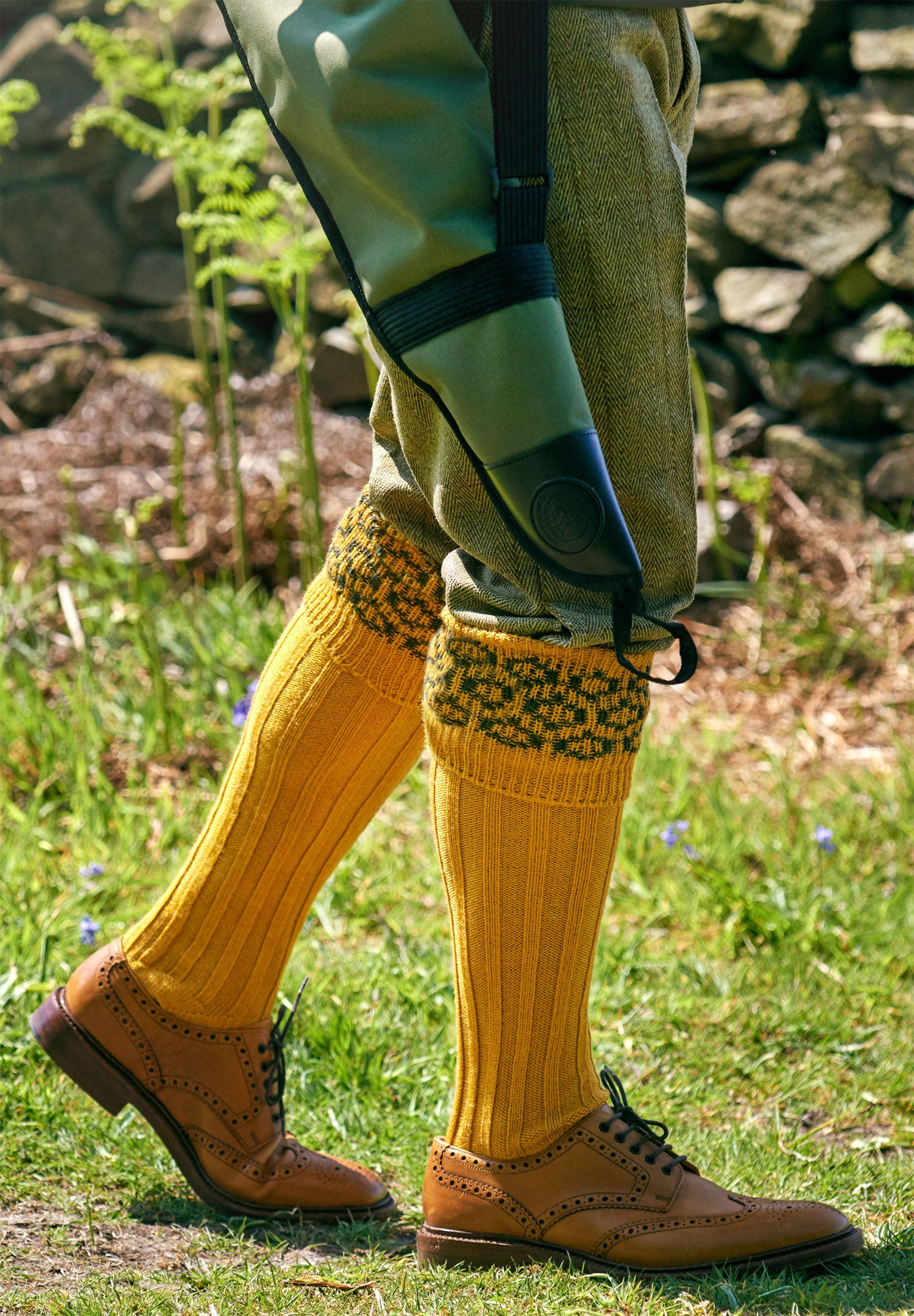 man wearing long shooting socks
