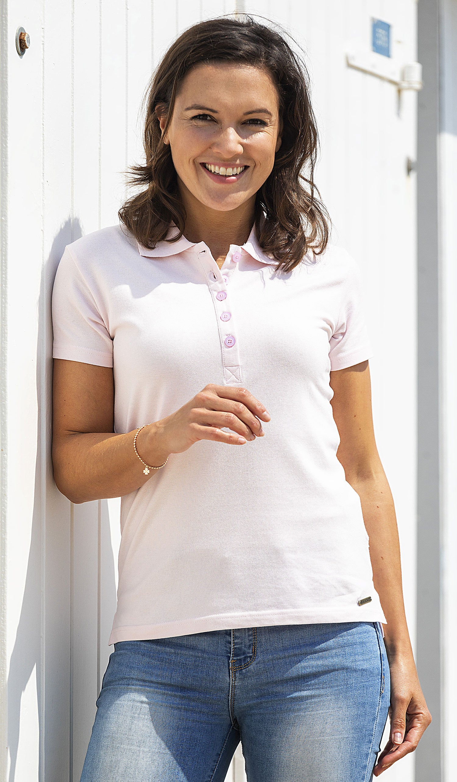 Woman in pink summer polo shirt