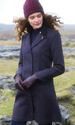 wearing a hat out in   field in jack murphy ladies three quarter tweed coat navy with red check overlay