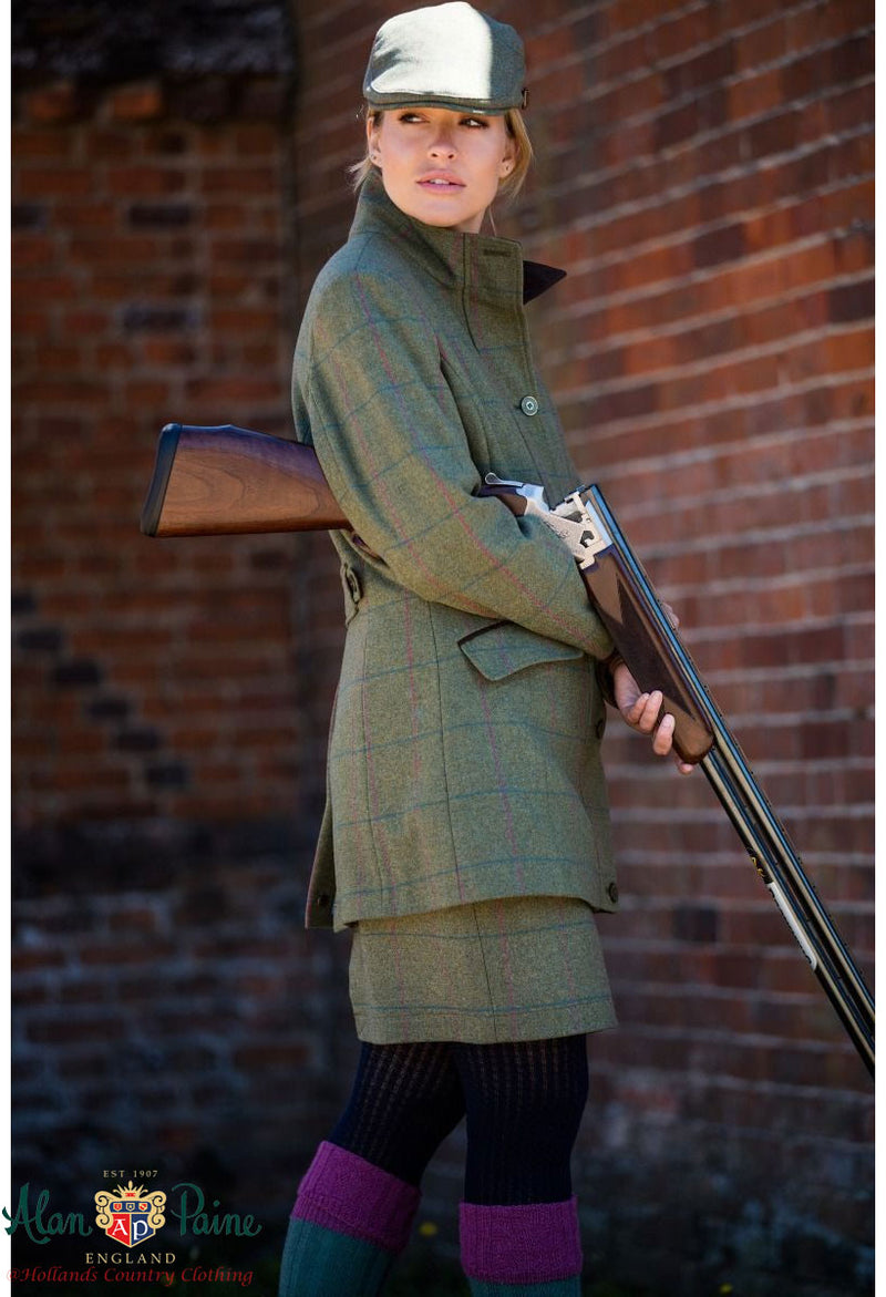 lady wearing Combrook Tweed Shooting Coat by Alan Paine