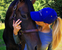 lady kissing horse in Sporting Hares Limited Edition Collection Cap