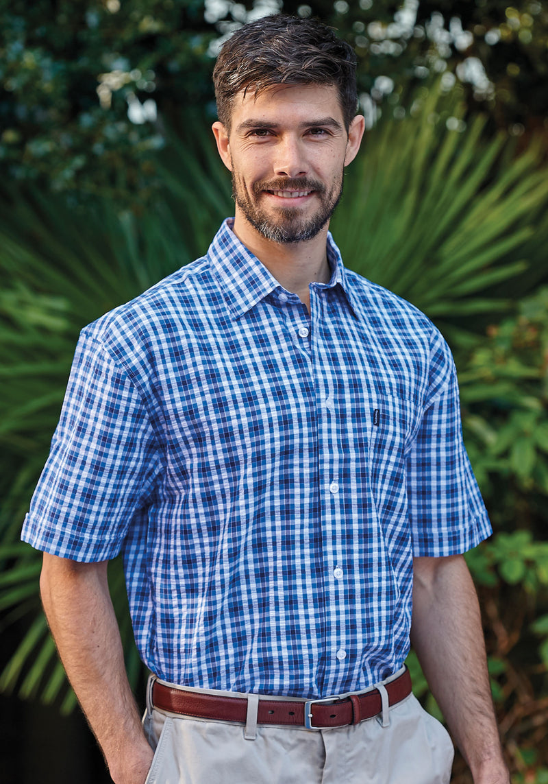 MAn in  a blue short sleeve check shirt