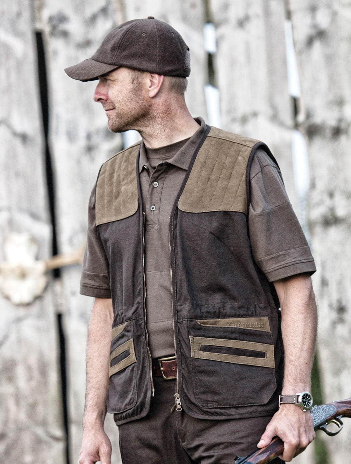 man with gun wearing Deerhunter Monteria Hunting Waistcoat
